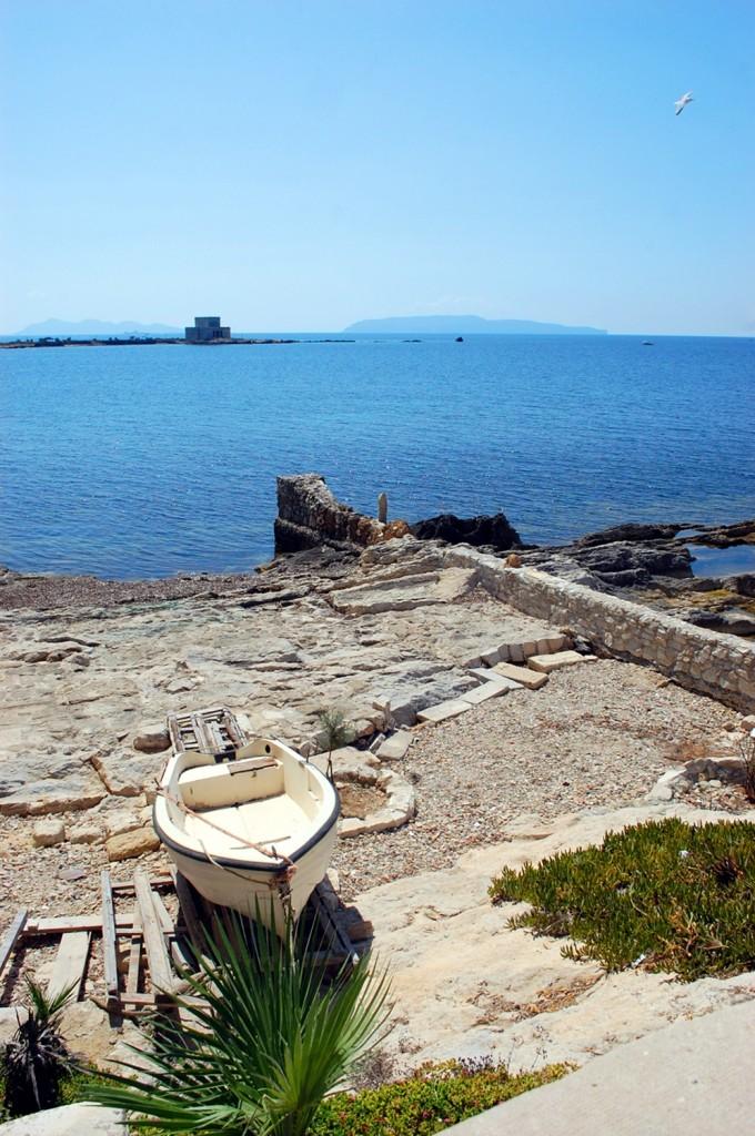 Trapani, a boat and the sea