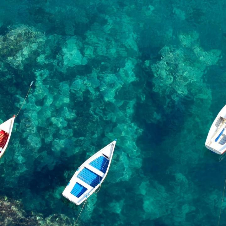 The stunning sea of Aci Castello and Taormina