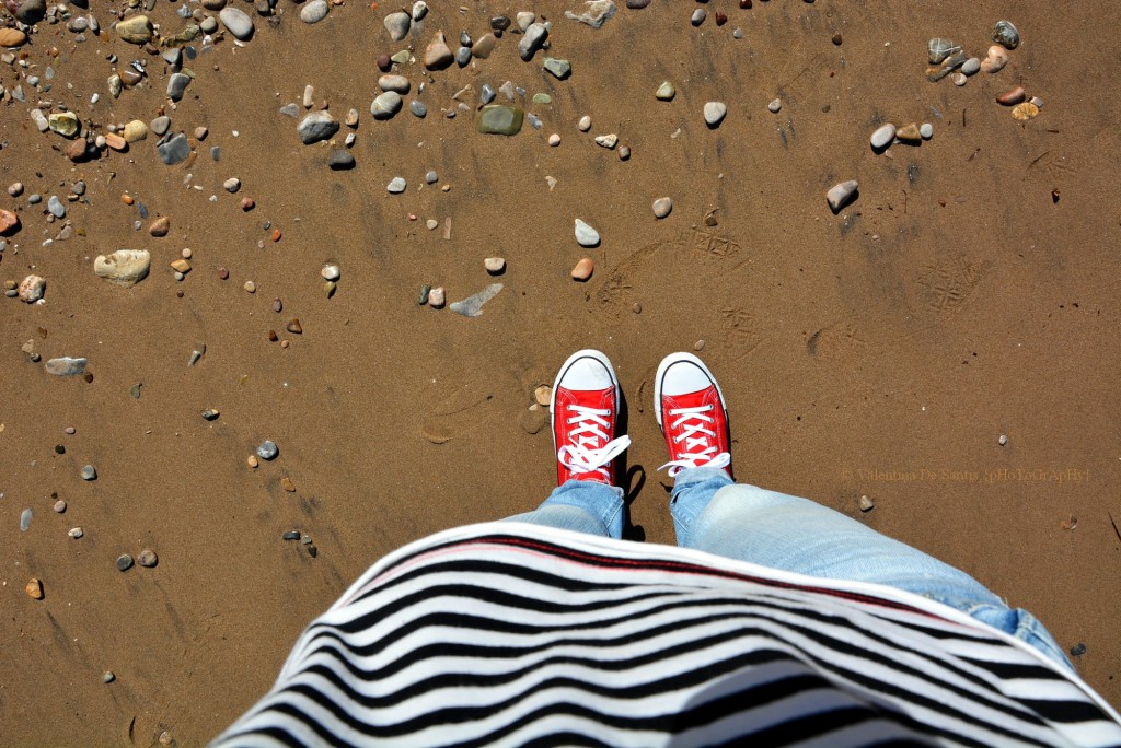 Shoes see beaches. Sneakers across the sands.